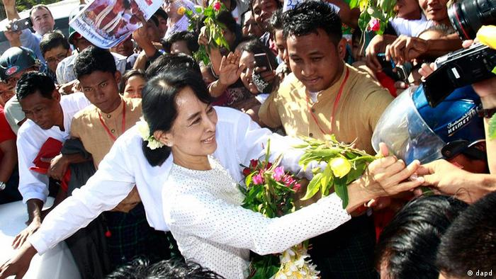 Aung San Suu Kyi greets a crowd in 2012