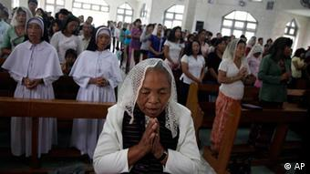 Kachin residents attend Sunday mass at a Catholic church in the border town of Laiza in Myanmar