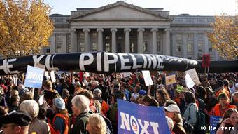 Demonstrators carry a giant mock pipeline while calling for the cancellation of the Keystone XL pipeline during a rally in Washington REUTERS/Joshua Roberts/Files (UNITED STATES - Tags: POLITICS CIVIL UNREST ENERGY)