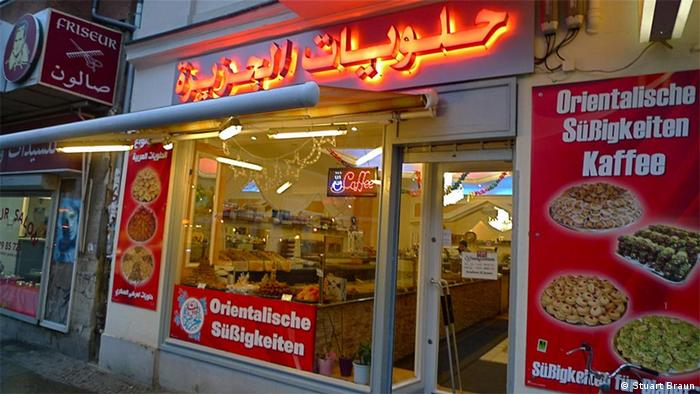 Al Jazeera pastry shop next to an Arabic barber on Sonnenallee, Berlin