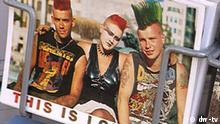A postcard from London, with an image of three punk-rockers