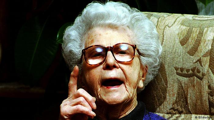 Old woman pointing her finger at someone