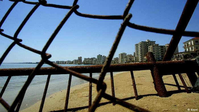 Deserted hotels in an area used by the Turkish military are seen through a wire fence in the Turkish-occupied coastal town of Famagusta, Cyprus (photo: ddp images/AP Photo/Petros Karadjias)