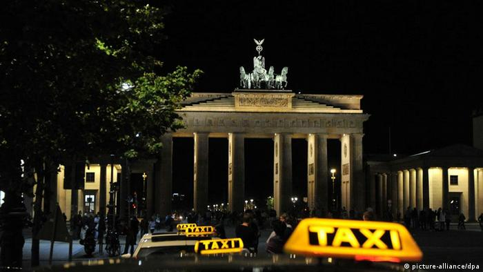 Taxis in front of the Brandenburg Gate