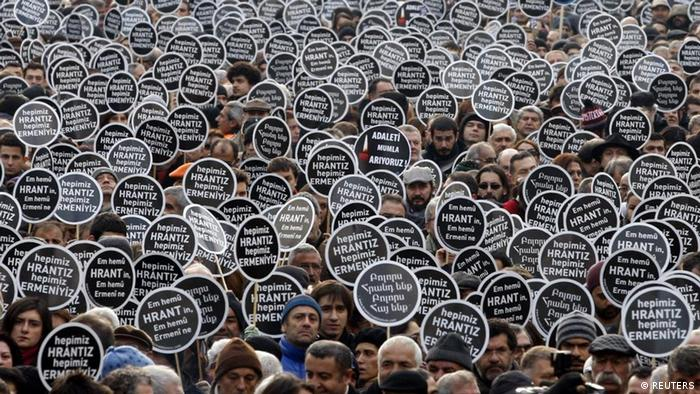 Istanbul - Schweigemarsch anlässlich der Ermordung des Journalisten Dink am 19.01.2007 Protesters gather in front of the Agos newspaper office during a demonstration to mark the fifth anniversary of the killing of Turkish-Armenian editor Hrant Dink in Istanbul January 19, 2012. A man was sentenced to life in prison in Turkey on Tuesday for the 2007 killing of prominent journalist Dink in a verdict that drew criticism from rights groups for failing to explore alleged complicity of state officials. Editor of the bilingual Turkish-Armenian weekly Agos and Turkey's best known Armenian voice abroad, Dink was shot in broad daylight in a busy Istanbul street as he left his office. Dink had angered Turkish nationalists with articles on Armenian identity and references to a Turkish genocide of Christian Armenians in 1915 - which the Turkish state strenuously denies. The case was seen as a test for democracy and human rights in European Union candidate Turkey. The placards in Turkish and Armenian read, We are all Hrant. We are all Armenians. REUTERS/Osman Orsal (TURKEY - Tags: POLITICS CIVIL UNREST MEDIA TPX IMAGES OF THE DAY)