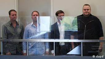Four Europeans, including Kim Dotcom (right)