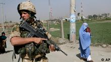 A British soldiar, from NATO, patrols in Kabul, Afghanistan, Thursday, July 27, 2006. NATO's expanding security and development mission in Afghanistan is the alliance's most challenging since the end of the Cold War, a NATO spokesman said Thursday. (AP Photo/Rodrigo Abd)