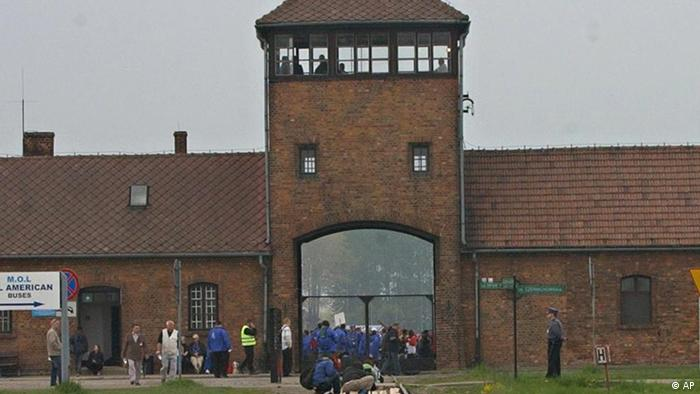 In this photo taken May 1, 2008 during the annual March of the Living, the entrance to the Aushwitz Birkenau former death camp is seen. Germany pledged 60 million euro, or $87 million to a new endowment for Auschwitz-Birkenau to preserve the barracks, gas chambers and other evidence of Nazi crimes at the former death camp. (AP Photo/Alik Keplicz)
