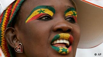 A Senegalese soccer fan wearing face paint in her country's colors waits for her team to play Angola in a group D match in the African Cup of Nations in Tamale, Ghana, Sunday, Jan. 27, 2008. (AP Photo/Alastair Grant)