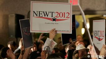 Supporters of Republican U.S. presidential candidate and former House Speaker Newt Gingrich hold up signs as they await his South Carolina Primary election night rally in Columbia, South Carolina, January 21, 2012. REUTERS/Mary Ann Chastain (UNITED STATES - Tags: POLITICS ELECTIONS POLITICS)