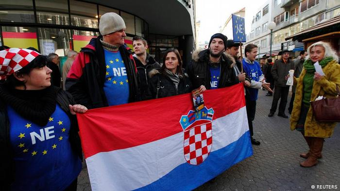 Eurosceptic protesters demonstrate against Croatia's signing of the European Union (EU) accession treaty at Zagreb's main square January 14, 2012. Croatia holds a referendum on the EU entry on January 22 with some 55 percent of citizens being in the pro-EU camp, according to the recent opinion polls. REUTERS/Nikola Solic (CROATIA - Tags: POLITICS CIVIL UNREST)