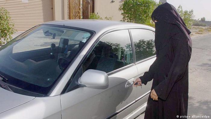 A woman in Saudi Arabia unlocks her car (Photo: Waseem Obeida)