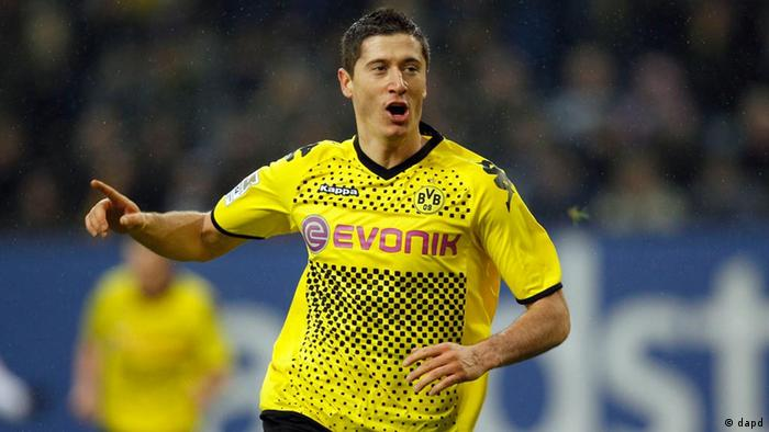 Dortmund's Robert Lewandowski of Poland celebrates his side's second goal during the German first division Bundesliga soccer match between Hamburger SV and Borussia Dortmund in Hamburg, Germany, Sunday, Jan. 22, 2012. (AP Photo/Michael Sohn) - NO MOBILE USE UNTIL 2 HOURS AFTER THE MATCH, WEBSITE USERS ARE OBLIGED TO COMPLY WITH DFL-RESTRICTIONS, SEE INSTRUCTIONS FOR DETAILS -