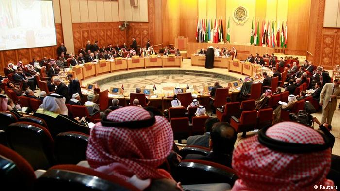 The empty chair of the Syrian delegate is seen during the Arab foreign ministers meeting at the Arab League headquarters in Cairo January 22, 2012. An Arab League committee on Syria will ask Arab foreign ministers on Sunday to extend a monitoring mission in the country by one month, sources attending the committee meeting said. REUTERS/Suhaib Salem (EGYPT - Tags: CIVIL UNREST POLITICS TPX IMAGES OF THE DAY CONFLICT)