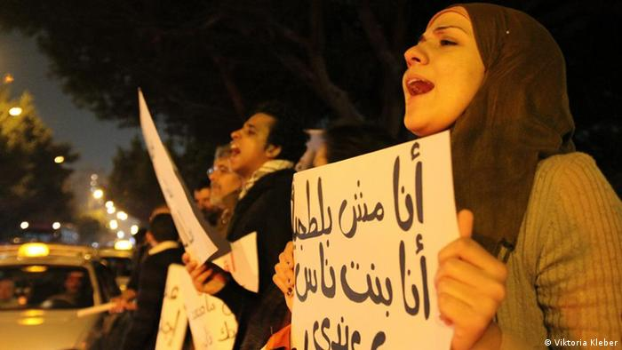 Protesters in Cairo holding signs for the military council to step down
