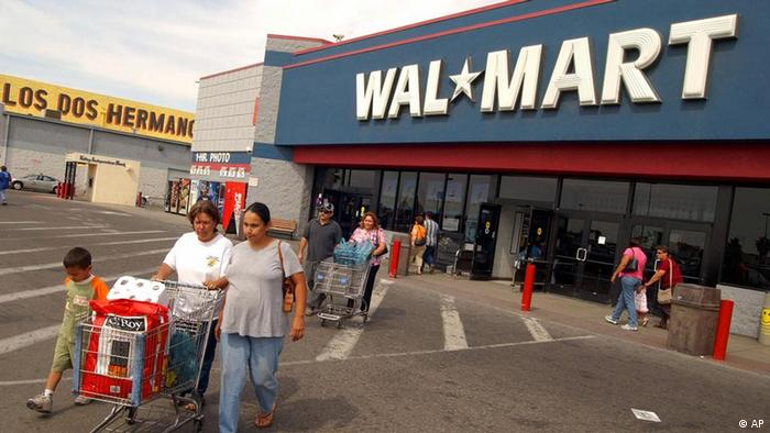 Customers leave a Walmart store in California.