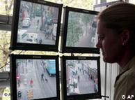 A police officer watches surveillance screens in Düsseldorf