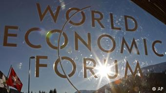 The sun shines through a logo at the World Economic Forum in Davos, Switzerland on Thursday, Jan. 27, 2011. Focus shifts on Thursday to the future of the euro and the issue of climate change. (ddp images/AP Photo/Michel Euler)