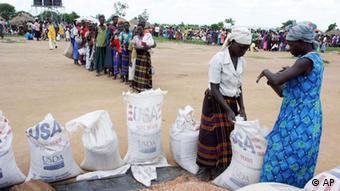 Women line up for food aid at a World Food Programme distribution center in northern Uganda. (ddp images/AP Photo)