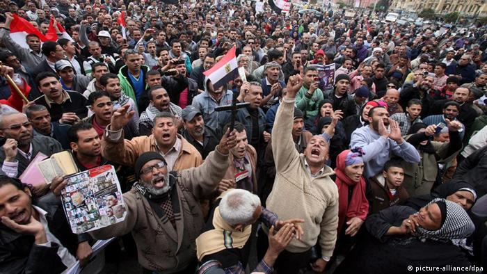 Egyptian protesters shouting slogans at Tahrir Square