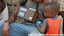 Man and a child with an old radio