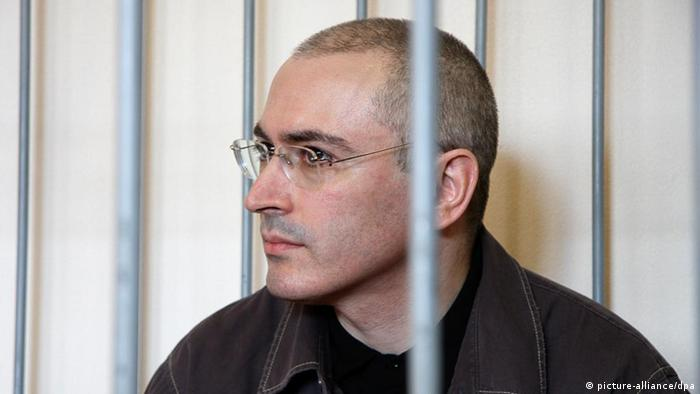 Mikhail Khodorkovsky behind bars during trial