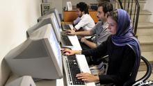 Iranians working  at an internet cafe in Tehran