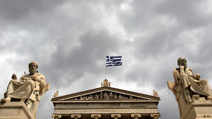 The marble statues of ancient Greek philosophers Socrates, right, and Plato left stand in front of the Athens Academy, as the Greek flag flies on Tuesday, April 19, 2011. Greece had to pay a higher rate to raise euro1.65 billion ($2.36 billion) on Tuesday as market pressures increased amid fears the government will have to default on its massive debt load. (AP Photo/ Petros Giannakouris)