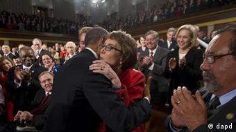 President Barack Obama embraces retiring Rep. Gabrielle Giffords