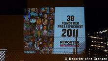 Lichtprojektion am 3. Mai 2011 Mit einer spektakulären Aktion hat ROG in der Nacht vom 2. auf den 3. Mai 2011 gegen die Verfolgung von Journalisten und die weltweiten Beschränkungen der Pressefreiheit protestiert Bild: Reporter ohne Grenzen