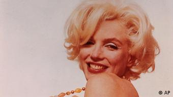 This photograph released by the Brooklyn Museum of Art, titled Marilyn Monroe: Pulling Beads, is part of show opening at the museum Friday, Nov. 12, 2004. The 1962 pink tinted photograph by Bert Stern is one of more than 200 Monroe pictures from 39 photographers - including luminaries such as Richard Avedon, Gordon Parks, Robert Frank and Andy Warhol - in the museum's new exhibit, I Want to Be Loved by You: Photographs of Marilyn Monroe. (ddp images/AP Photo/Brooklyn Museum of Art, Bert Stern)