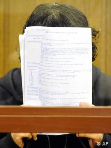Austrian Maqsood Lodin hiding his face in the Berlin court room