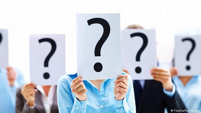 Fotolia 12376781 Business people with question mark on boards © Yuri Arcurs
