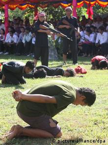 A scene from the killing field is shown during a ceremony at Choeung Ek Genocidal Center in Phnom Penh