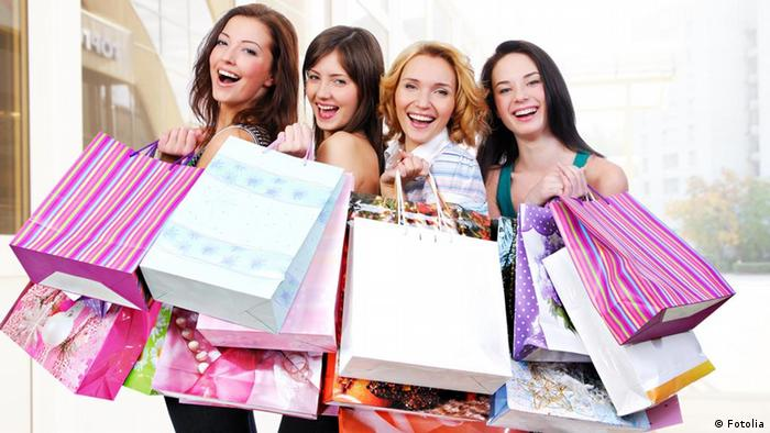 Young women showing their filled shopping bags