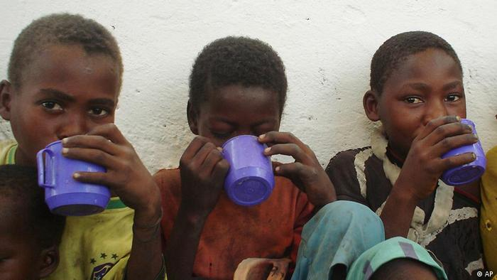 Somali children enjoy a liquid food drink in the port town of Kismayo