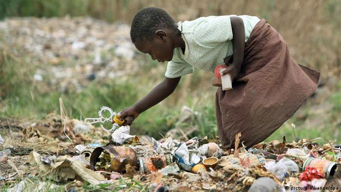 A young girl rummaging through waste to salvage valuables