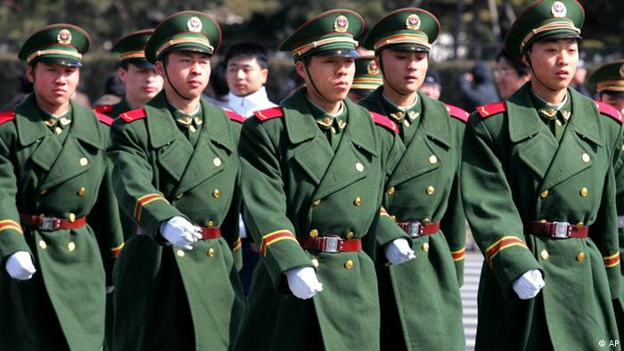 Chinese paramilitary police officers march on Tiananmen Square near the Great Hall of the People as security is tightened in the area in preparation for the National People's Congress, in the Chinese capital of Beijing Friday, March 4, 2005. The annual session of the NPC begins on Saturday. (AP Photo/Greg Baker)