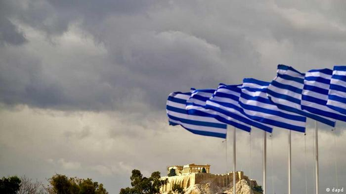 Greek flags in front of the Acropolis in Athens