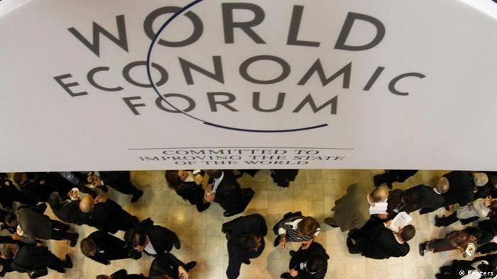 Visitors attend the World Economic Forum (WEF) in Davos, January 25, 2012. Picture rotated 180 degrees. REUTERS/Christian Hartmann (SWITZERLAND - Tags: POLITICS BUSINESS)