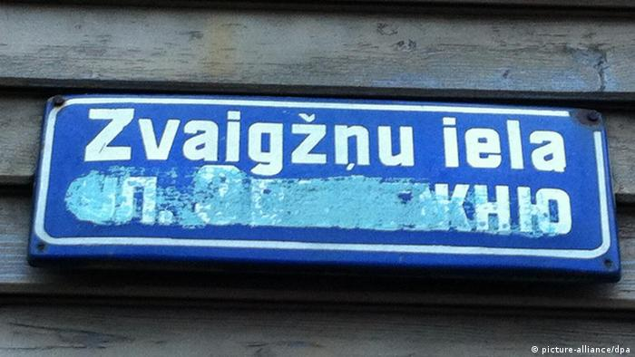 Latvian sign with Russian name obscured