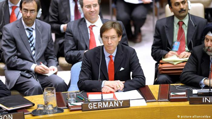 epa02639093 Germany's Ambassador to the United Nations, Peter Wittig abstains on a vote during UN Security Council meeting on a resolution that would impose a no-fly zone over Libya and authorize all necessary measures to protect civilians from attacks by Muammar Gaddafi's forces, at United Nations Headquarters in New York USA, 17, March 2011. EPA/PETER FOLEY