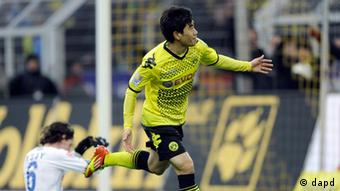 Dortmund's Shinji Kagawa of Japan, right, scores the opening goal during the German first division Bundesliga soccer match between Borussia Dortmund and Hoffenheim in Dortmund, Germany, Saturday, Jan. 28, 2012. (AP Photo/Martin Meissner) - NO MOBILE USE UNTIL 2 HOURS AFTER THE MATCH, WEBSITE USERS ARE OBLIGED TO COMPLY WITH DFL-RESTRICTIONS, SEE INSTRUCTIONS FOR DETAILS -