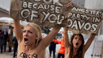 Topless protesters demonstrate at the entrance to the congress center where the World Economic Forum takes place in Davos (Photo: Anja Niedringhaus)