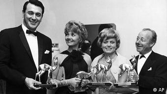 Holding their Bambi Film Awards on April 28, 1963 at the Schwarzwaldhalle (Black Forest Hall) in Karlsruhe, Germany are from left to right: US actor Rock Hudson, Swiss actress Liselotte Pulver, Austrian actress Luise Ullrich and German actor Heinz Ruehmann. (ddp images/AP Photo)