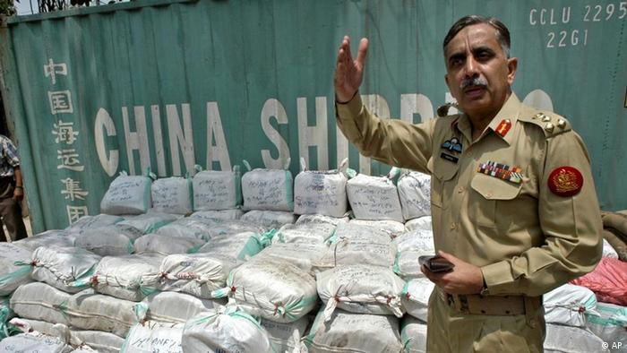 Pakistani Brigadier General Ashfaqur Rashid Khan stands before drug cargo detected in a shipping container by his anti-narcotics unit