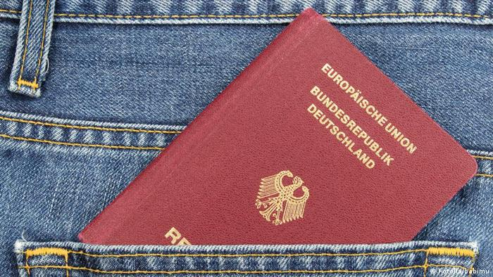 A German passport in a back pocket