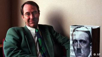British historian Ian Kershaw poses with the first installlment of his big two-volume biography of Adolf Hitler, in Sheffield, England, Oct.19 1998. A chance conversation in a German cafe more than two decades ago with a man who nonchalantly expressed anti-Semitic feelings prompted Kershaw to spend years researching the life of Adolf Hitler. (AP Photo/Graham Heathcote)