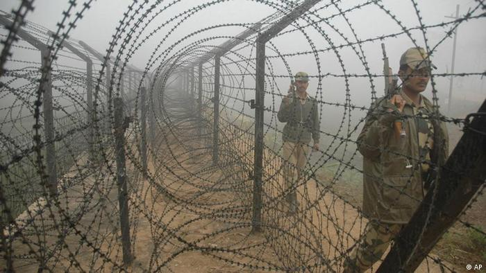 Indian Border Security Force soldiers patrol in the early morning fog along barbwire fence along the India Bangladesh border in Jaipur village near Agartala, capital of India?s northeastern state Tripura, Monday, Dec. 4, 2006. Security along the border has been intensified following Political instability and continuing violence in Bangladesh. India shares over 4,000 kilometers (2500 miles) border with Bangladesh. (AP Photo/Ramakanta Dey)
