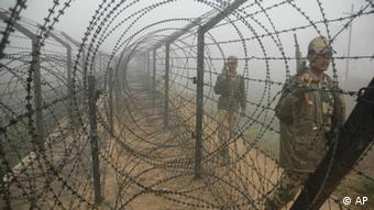 Indian Border Security Force soldiers patrol in the early morning fog